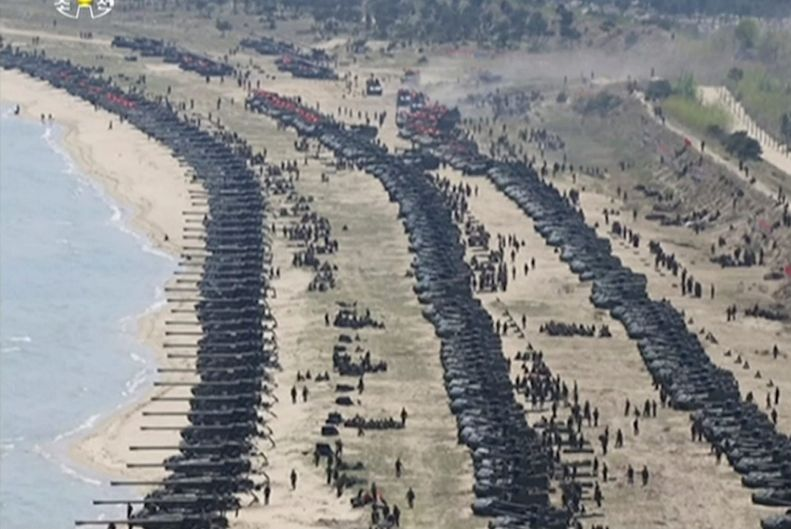 Tanks mass on a beach in North Korea as part of the live-fire drills.