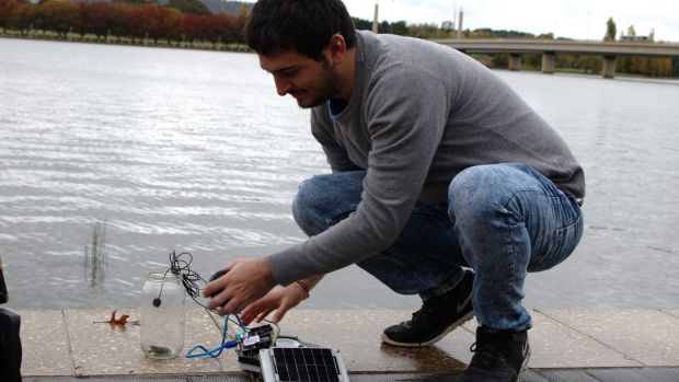 University of Canberra student and research assistant Lorenzo Bertolelli sets up the IoT listening device with a captive ...