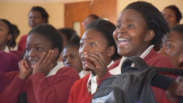 Students react to a science demonstration from Science Circus Africa.