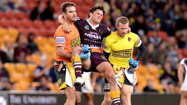Clipped wings: Broncos paceman and Origin hopeful James Roberts is carried from the field after his leg collided with a ...