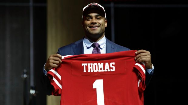 No.1: Stanford University star Solomon Thomas poses after being selected by the San Francisco 49ers.
