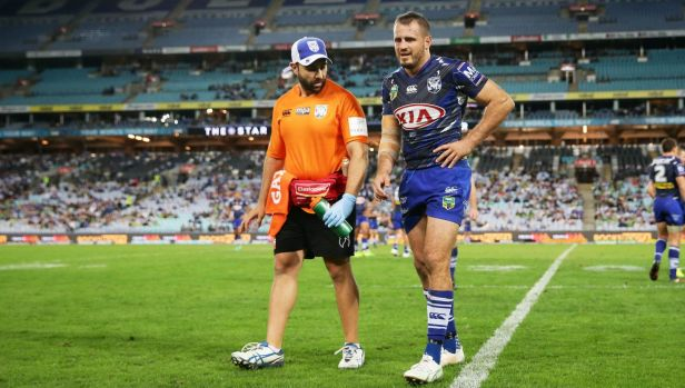 Hamstring injury: Josh Reynolds limps off the field  on Saturday.