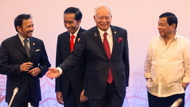 From left, Sultan Hassanal Bolkiah of Brunei Darussalam, Indonesian President Joko Widodo, Malaysian PM Najib Razak and ...