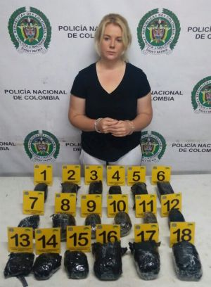 Colombian police released this photo of Cassandra Sainsbury with the drugs she is alleged to have smuggled.