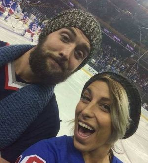 Mr Reid and Ms Kancso at a New York Rangers game; Ms Kancso is trying to raise money for Mr Reid's legal bills.