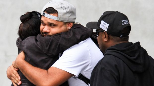 Lewis Warria hugs a supporter after leaving a Mental Health Court hearing into the deaths of seven of his siblings at ...