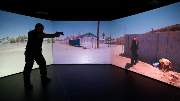 A Victorian policeman using the force's new simulator used for active shooter training.