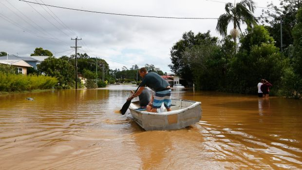 The new normal? Residents paddle down a street in Murwillumbah in March after heavy rains led to flash flooding.