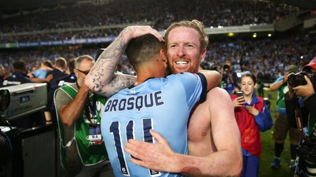 Alex Brosque and David Carney of Sydney celebrate after the penalty shoot-out in the 2017 A-League grand final.