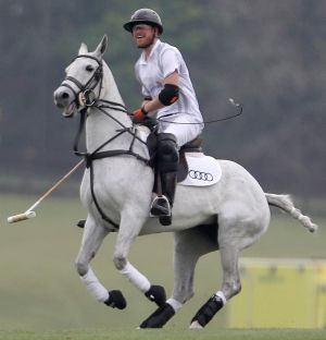 Britain's Prince Harry takes part in the annual Audi Polo Challenge at Coworth Park polo club in Ascot.