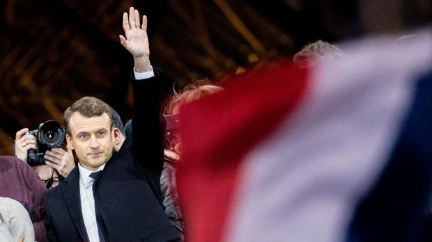 Emmanuel Macron, French presidential candidate, waves to supporters in front of the Pyramid at the Louvre Museum in Paris.