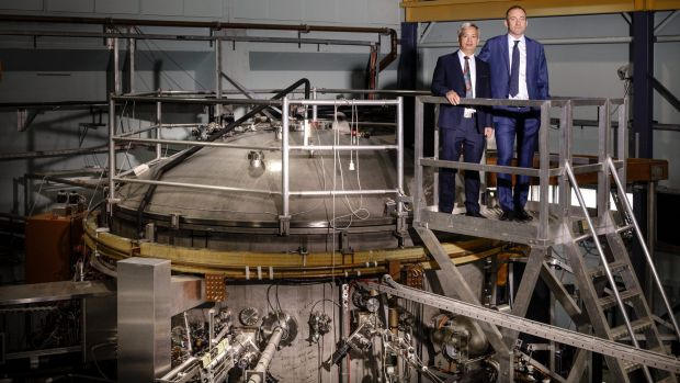 Director of the Australian Plasma Fusion Research Facility at ANU Dr Cormac Corr, right, standing with University of ...