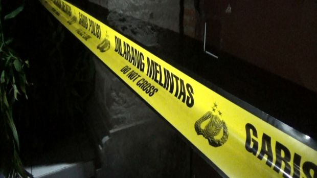 Police tape outside a house in Sanur, Bali, where the body of an Australian man was found.