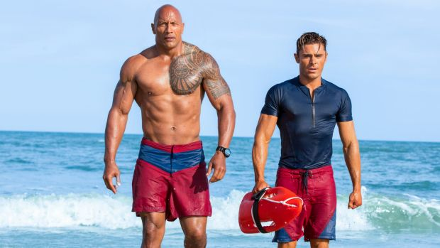 The extremely large Dwayne Johnson with an extremely hungry-looking Zac Efron.