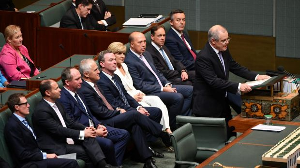 Coalition ministers watch on as Scott Morrison delivers the budget speech.