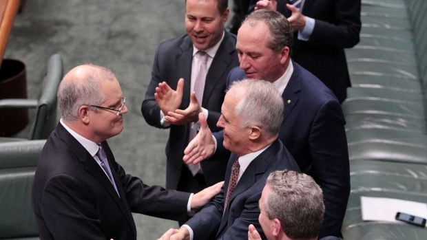 Treasurer Scott Morrison is congratulated by the Prime Minister.