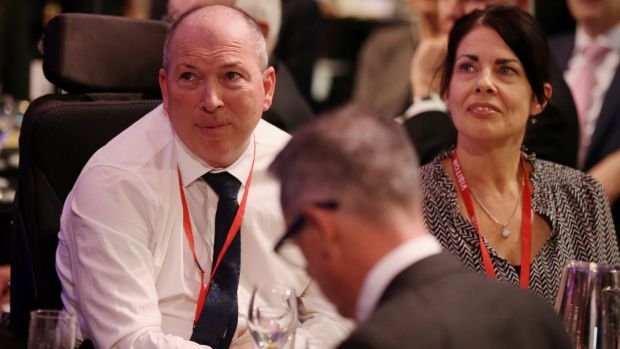 Gary Warren and his wife Michelle listen as Treasurer Scott Morrison shares their story.