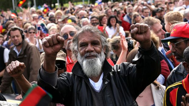 Reg Edwards raises his fists in triumph outside Parliament House after watching a live broadcast of Kevin Rudd's apology ...