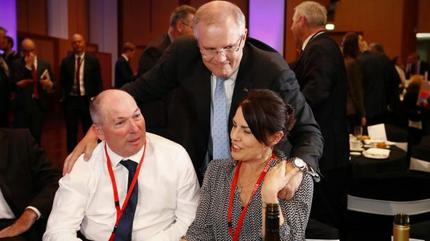 Treasurer Scott Morrison with his brother-in-law Gary Warren and his wife Michelle Warren.