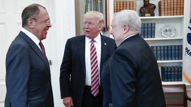 US President Donald Trump with Russian Foreign Minister Sergey Lavrov, left, and Russian ambassador to the US Sergey ...