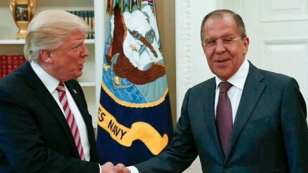 US President Donald Trump shakes hands with Russian Foreign Minister Sergey Lavrov in the White House in Washington.