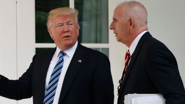 Donald Trump walks with protection officer Keith Schiller to the Oval Office.