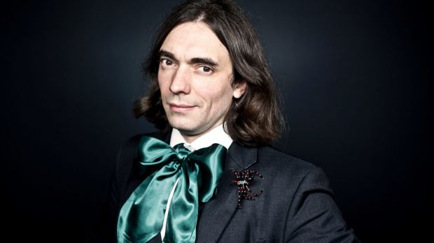 Prize-winning mathematician Cedric Villani with one of his many trademark spider brooches.