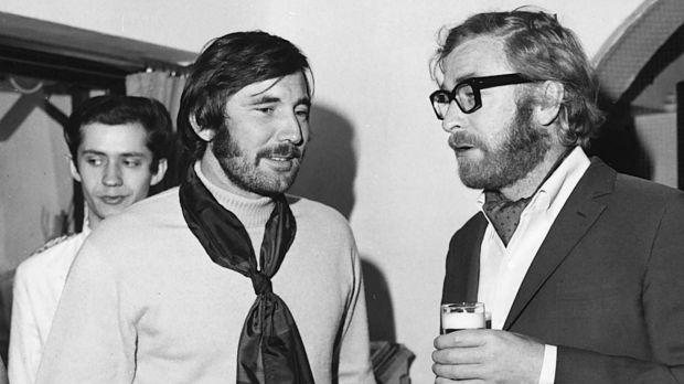Lazenby (left) with Michael Caine at the height of his fame. He refused to shave his beard for the Bond press tour.