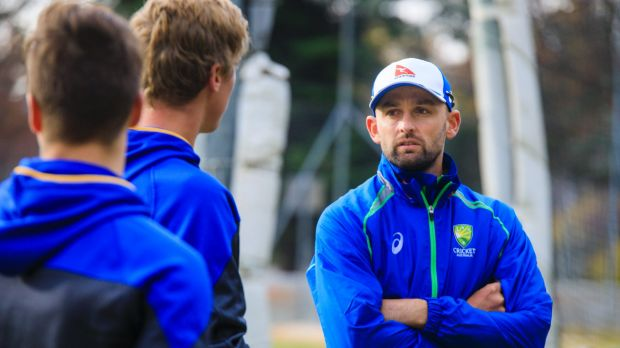 Nathan Lyon gives some advice to Tom Vane-Tempest and Ben Taylor.