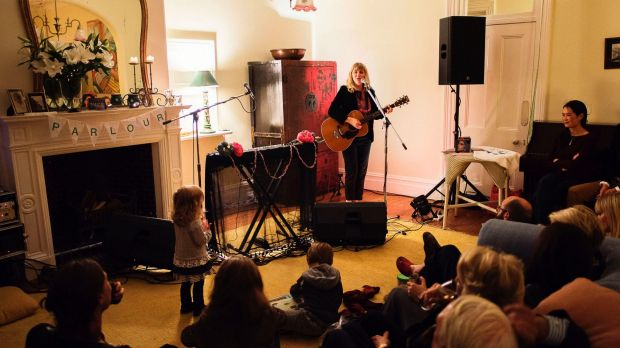The loungeroom doubles as a stage as Sally Seltmann performs at a housewarming party.
