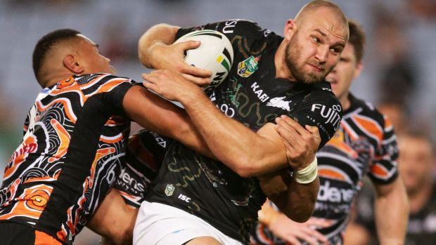 Go-forward: Robbie Rochow is tackled at ANZ Stadium.