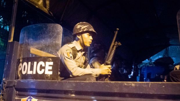 Police officers provide security in Yangon following violence against Muslims.