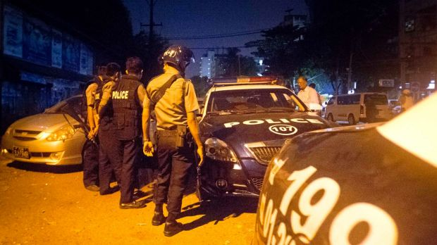 Police officers keeping the peace in Mingala Taungnyunt township in Yangon where Buddhist hardliners clashed with Muslim ...