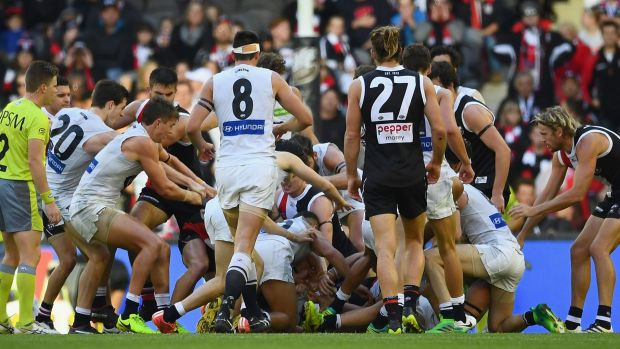 A melee erupts after St Kilda players sledged Marc Murphy