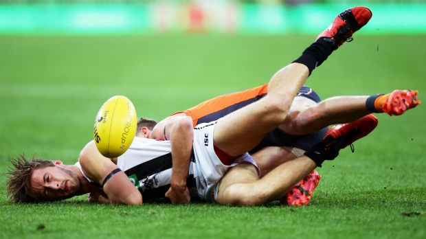 Grounded: Magpie Tom Phillips is tackled by returning Giant Lachie Whitfield.