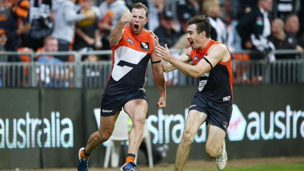 Pumped: Steve Johnson celebrates after kicking the winning goal.