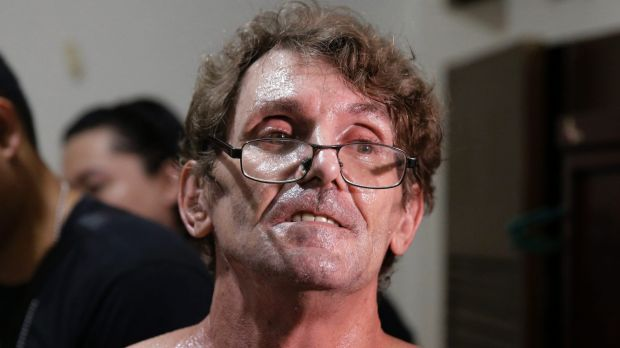 David Timothy Deakin, from Peoria, Illinois, following his arrest on April 20. A Queensland man has since been arrested ...