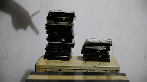 Computer hard drives gathered by members of the Philippines' National Bureau of Investigation anti-human trafficking ...