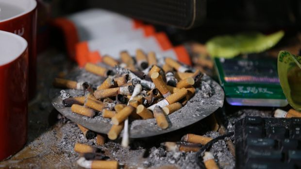 Cigarettes overflow from an ashtray in the home of suspected child webcam cybersex operator, David Timothy Deakin, in ...