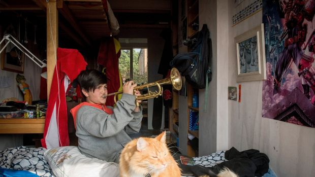 Ten-year-old Sidney Bertram playing his Dad's trumpet - one of three instruments he can play.