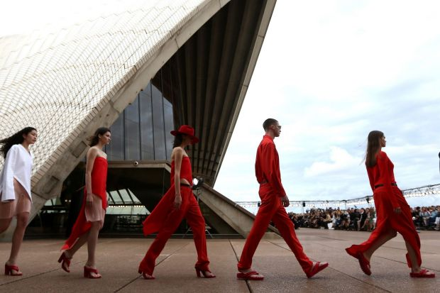 Strong flashes of red and sleek tailoring.