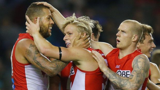 Lance Franklin of the Swans with Isacc Heeney and Zak Jones.