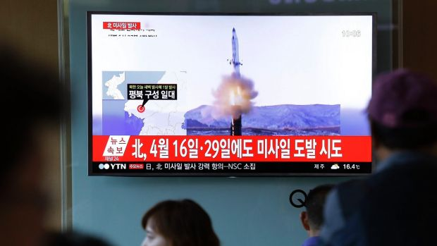 A television screen at Seoul Station on Sunday shows a news broadcast on North Korea's ballistic missile launch.