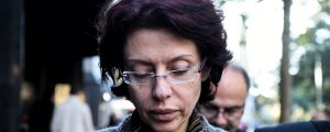 Eman Sharobeem leaves an ICAC hearing where she was accused of fraud over nearly a decade.