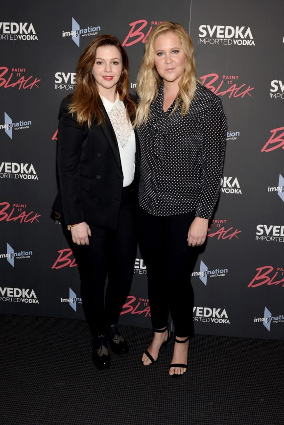 """Amber Tamblyn (L) and Amy Schumer attend the """"Paint It Black"""" New York premiere at The Museum of Modern Art on May 15, ..."""