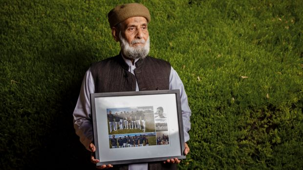 Muhammad Akbar Abbasi with photos of his son Zeeshan Akbar, who was tragically killed on April 7 while working at a ...