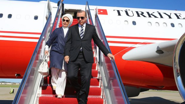 Turkey's President Recep Tayyip Erdogan and his wife Emine disembark from a plane after arriving in Washington.