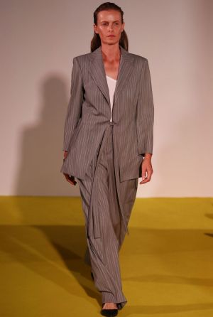 A model walks the runway during the Christopher Esber show at Mercedes-Benz Fashion Week.