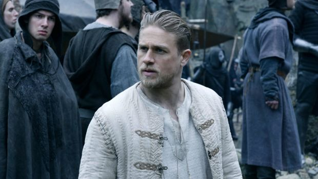Charlie Hunnam portrays the young Arthur as an amiable chancer in King Arthur: Legend of the Sword.