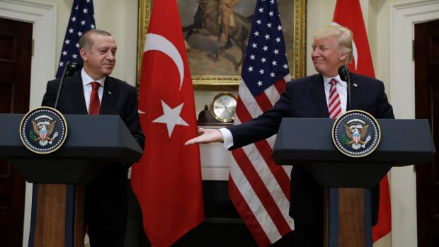 US President Donald Trump reaches to shake hands with Turkish President Recep Tayyip Erdogan in Washington on Tuesday.